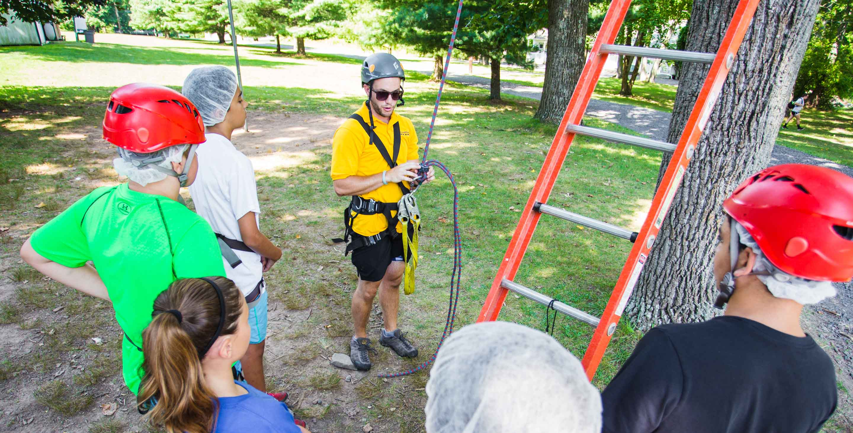 Specialist staff with children by ropes course