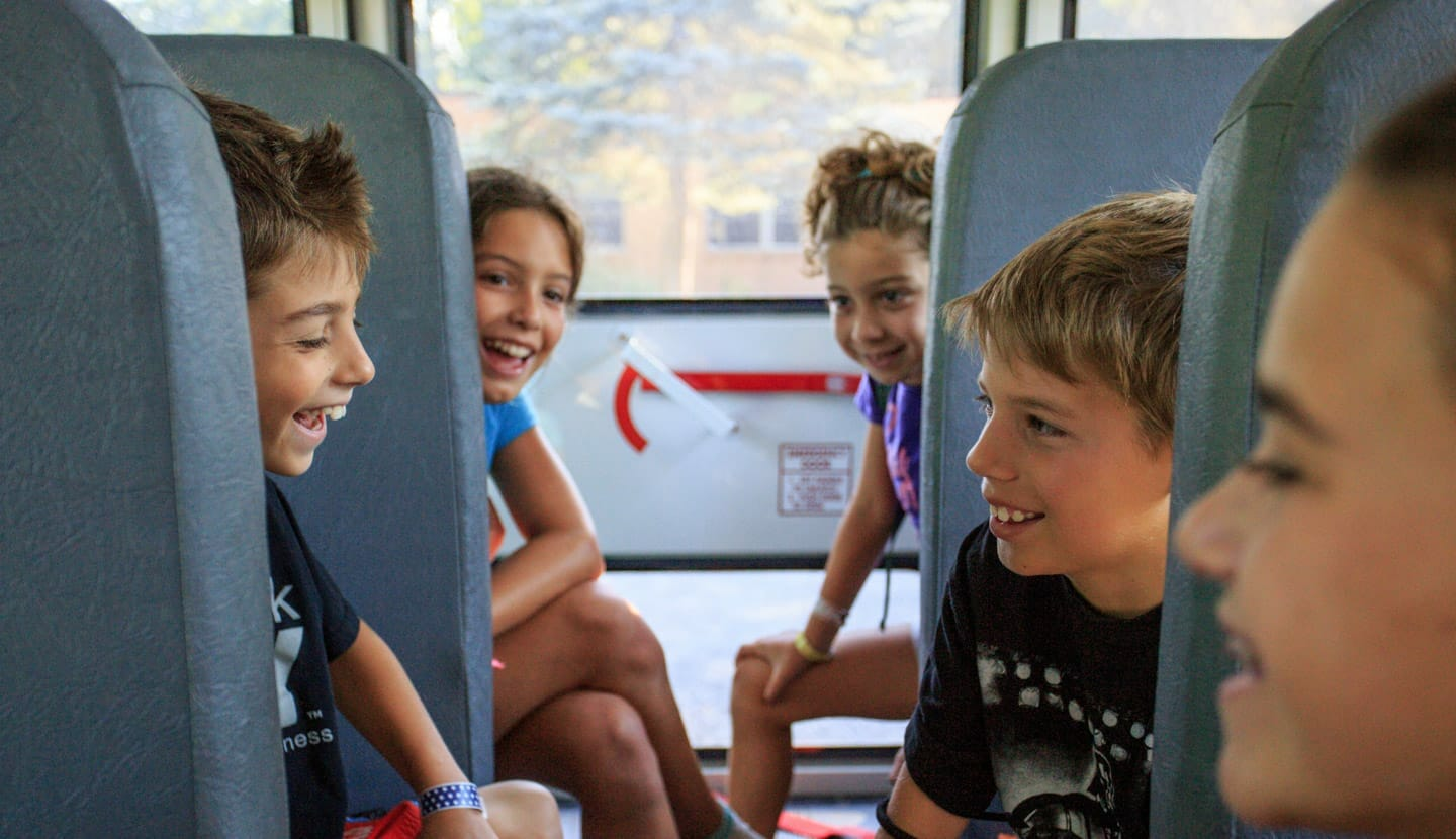Kids riding the bus to camp